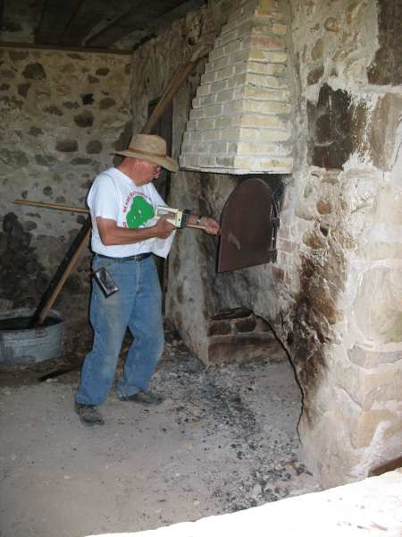 Walter checking the temperature of the Brick Oven